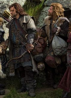Kili and Fili, next to Thorin (looking at Kili's bow). That's a lot of bags Fili's carrying!