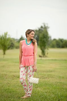 Shaw Avenue // Coral & turquoise // naturally curly hair // floral pants // coral shirt // turquoise and coral necklace // Jack Rogers cork sandals // Kate Spade purse  // www.shawave.com