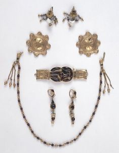 Several items of jewelry excavated in 1892 in Aegina, c. ( The pieces are made of gold, for the most part, and the small discs are thought to be decorative pins or brooches of some sort. Roman Jewelry, Minoan, Body Adornment, Gold Flowers, White Enamel, British Museum, Garnet, Pendants, Chapter 3