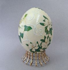 Ostrich Egg Hand decorated Easter egg Easter decor Spring decor Ostrich egg decor Decoupaged ostrich egg Floral pattern Ostrich eggshell Easter gift Easter egg    This beautiful ostrich egg. Decorated by skillful decoupage and hand painted. It has a stand for this decorated egg included in the price, you see it in the pictures. The egg has been evacuated, cleaned. A small hole on bottom of the egg was decorated.   Perfect as a gift or beautiful accent for your home! This decorated egg very…