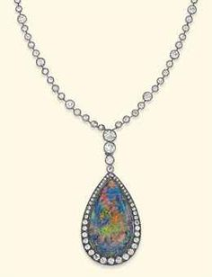 AN ANTIQUE OPAL AND DIAMOND PENDENT NECKLACE  The pear-shaped black opal pendant mounted within a circular-cut diamond surround, suspended from a line of graduated collets to the similarly-set diamond collet neckchain, mounted in silver and gold, circa 1890