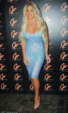 Barbie girl: Bianca's blonde locks looked longer than ever and reached to her waist Bianca Gascoigne, Evening Attire, Bleach Blonde, Launch Party, Blonde Beauty, Martini, Locks, Fashion Inspiration, Strapless Dress