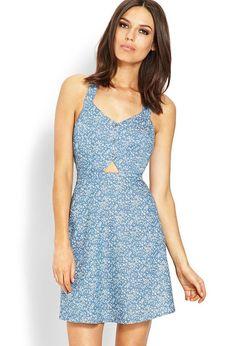 Love 21 - A denim dress featuring a floral print and crossback detail. V-neckline. Partial button...