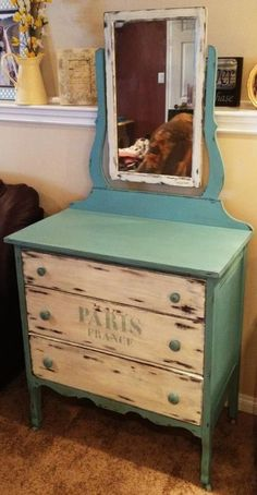 Shabby chic dresser. Love the dual-tones, using teal for the frame and off-white for the drawers  mirror.
