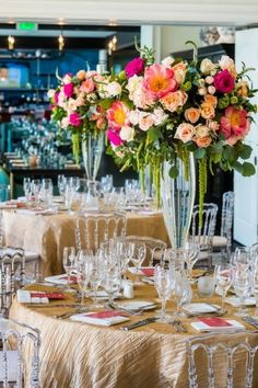 Tall wedding centerpiece with pink, coral, green, and champagne accents. Coral Wedding Themes, Pink Green Wedding, Bright Wedding Colors, Beach Wedding Colors, Bright Flowers, Floral Wedding, Wedding Flowers, Wedding Ideas, Green Weddings