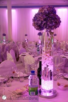 Modern Wedding Flower Centerpiece: Purple Hydrangeas, White Dendrobium Orchids in Tall Light Up Cylinder Vase | A Timeless Celebration Montreal Florist