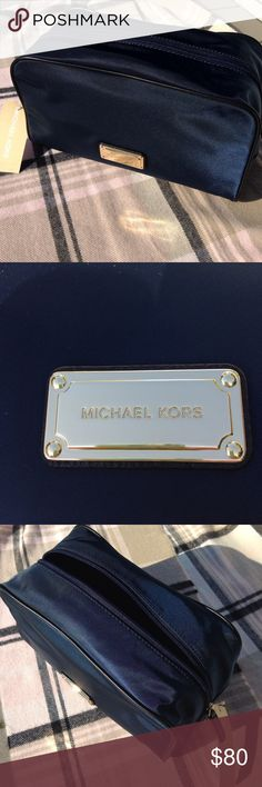 ⏰2 HR SALE⏰ Michael Kors Lrge Makeup or Travel Bag Michael Kors Navy blue with black detail piping. Large makeup or travel bag. Authentic Michael Kors Can also be a men's toiletries bag. NWT 10 x 6 x 4 1/2 Comes with Michael Kors Shopping bag MICHAEL Michael Kors Bags Cosmetic Bags & Cases