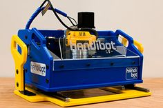 "Handibot® http://www.handibot.com ""... If you're familiar with industrial CNC (computer numerically controlled) equipment, think of the Handibot tool as a portable version of CNC. But instead of taking material to a stationary machine, you bring the Handibot to your material -- your jobsite, your remodeling task, your project, your work..."""