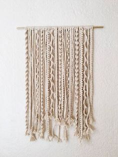 """24"""" across and 33"""" long.(Includes the wooden dowel rod) 100% natural cotton cord Each wall hanging is made by me I also do custom orders"""