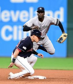 October 11, 2017:  ALDS Game 5: Yankees at Indians  -  New York Yankees' Didi Gregorius, top, watches his throw to first after forcing out Cleveland Indians' Giovanny Urshela at second base in the fifth inning of Game 5 of a baseball American League Division Series, Wednesday, Oct. 11, 2017, in Cleveland. Francisco Lindor was out at first base for the double play.