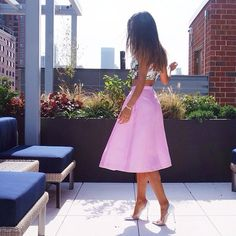 Click the photo to shop the look | Aimee Song of Song Of Style wearing a Tibi pink mini skirt, and Gianvito Rossi pumps | Follow @liketkit on Pinterest for more outfit inspiration #liketkit