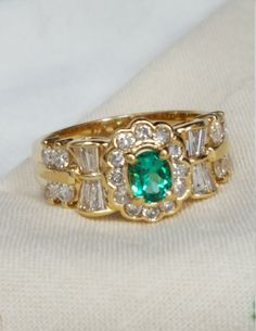 Brand new custom made 14kt. yellow gold Vintage inspired oval Emerald and round, baguette diamond ring by vintagejewelry101 on Etsy