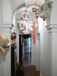 Chinese lanterns in the hallway.... maybe not these, but maybe those DIY yarn ball globes I've seen on Pinterest?