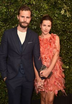 Look at this beautiful couple! #JamieDornan and wife #AmeliaWarner attended the Chanel and Charles Finch Pre-Oscar dinner in Los Angeles (March 3, 2018).