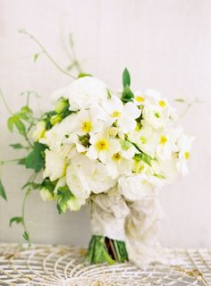 Camellia, Ivy, Spray Roses, Ranunculus