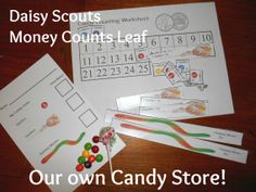 """Daisy Scout """"Money Counts"""" Leaf Petal activity. We did a candy store activity. The girls got 25 cents to spend on candy. They got a chart with squares numbered 1-25 and slips of paper with pictures and prices of candy. They could buy 25 cents' worth of candy by using the number chart to put together candy in any combination up to 25 cents, then they filled out an order form and traded it in for candy. All forms at: https://drive.google.com/folderview?id=0B23WOj9Zj6W_UU5PMFQzdk5XcFU&usp=shari..."""