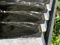 Granite water Sculpture  -Designed by McQuiggin's Inc,  -Stone Carving by 'Poetry in Stone' -Install by McQuiggin's Inc.