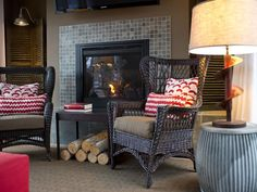 A direct-vent gas fireplace serves as the room's heat source. The surround and hearth, clad in slate tile, complement the room's selection of rustic and industrial home furnishings.