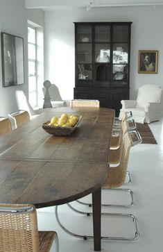 Antique table + modern chairs, all simple lines.   kathleen clements design