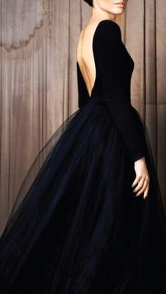 A beautiful backless dress in classic black.