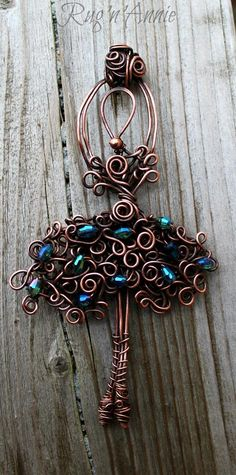 Funky Ballerina.  Copper wire and crystals. I love MaryAnn's distinctive crazy curls style.