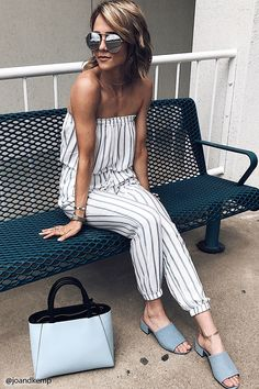 Forever 21 Contemporary - A semi-sheer woven jumpsuit featuring a stripe pattern, an elasticized strapless neckline with a ruffle trim, an elasticized drawstring waistband with tassel ends, front slant pockets, mock back welt pockets,  and an elasticized hem.