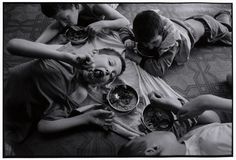 BELARUS. 1997. Novinki Asylum, Minsk. The boys on the floor. The children are fed on the floor.    Paul Fusco/Magnum Photos