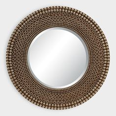Introduce a bold, antiqued accent into your household with our sizeable circular mirror. Crafted with a bronze dot pattern around the rim and a center beveled mirror, this piece catches eyes with its fashionable texture.