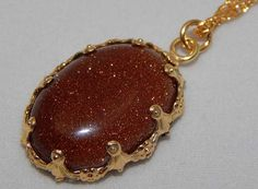 Brown Goldstone Pendant in GoldFilled Setting. by PebblesnPaint