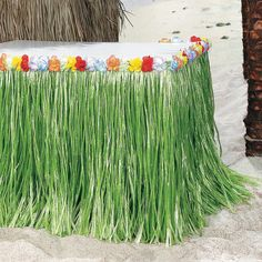**Tropical Flowered Table Skirt - OrientalTrading.com - make our own from green table cloths?