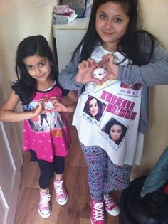 zayn's sisters wearing little mix outfits and have hearts around perrie<3 SO CUTE :3