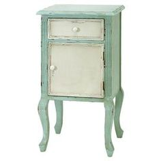 """1-drawer nightstand with a lower cabinet and cabriole legs.      Product: NightstandConstruction Material: Wood and veneersColor: Distressed green and ivoryFeatures:  One drawerOne lower cabinetMade in the USA Dimensions: 35"""" H x 23"""" W x 16"""" D"""
