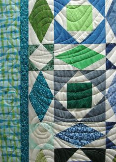 Close-up of spiral and wave quilting by Candy Stiffler at Quilt Vine: Storm at Sea quilt by the 7-Sisters Quilt Guild