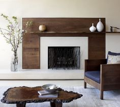 natural wood surround, wooden fireplace mantle, wrought iron twig screen