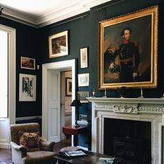 Love the rich dark wall colour, which contrasted beautifully against the fireplace and gilt frames. Dark Green Living Room, Dark Green Walls, Green Rooms, Blue Rooms, My Living Room, Home And Living, Living Room Wall Designs, Dyi, Georgian Interiors