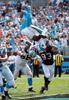 It's a bird! It's a plane! It's...CAM NEWTON?! Yes, in Week 2 Cam rushed for an epic TD against the Houston Texans that involved this 360-degree flip-and-score. (Paul Spinelli via AP)