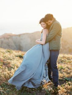 A dusty blue dress and sweeping skyline: http://www.stylemepretty.com/2014/11/22/natural-outdoor-engagement-inspiration/   Photography: Jacque Lynn - http://jacquelynnphoto.com/   Photography: Design: Ginny Au - http://www.ginnyau.com/