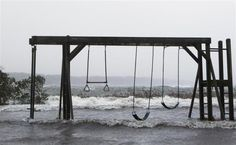 A swing set stands flooded by storm surf kicked up by the high winds from Hurricane Sandy in Southampton, New York