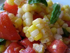 Fresh Corn And Tomato Salad - 6 ears corn - 3 large tomatoes - large onion - fresh basil - fresh oregano - white vinegar - olive oil - coarse sea salt - freshly ground pepper - A Bountiful Kitchen