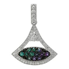 18K White Gold, 0.62CTW Alexandrite, 0.41CTW Diamond Pendant with Chain by Mark Henry Jewelry. Alexandrite is an extremely rare gemstone that dramatically changes color from vibrant green in daylight to deep purple in artificial light. We now carry Alexandrite Jewelry at www.gemcollection.com #Alexandrite #AlexandriteJewelry