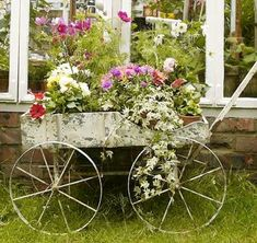I scored a free wooden flower cart over the summer!  I might have to do something like this with it