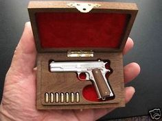 1:3 scale handmade miniature Colt M1911 made in .925 silver with walnut presenation box.