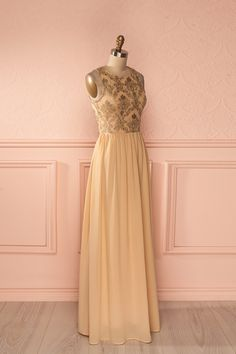 Lorsque les violons chantent, les coeurs dansent en harmonie.  When violins sing, hearts dance in harmony.  Beige and gold embroidered maxi dress www.1861.ca