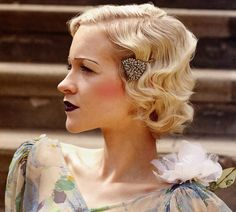 During the flapper era, fashions were boyish. Women's figures were hidden beneath straight-cut dresses, hemlines became shorter and so did hair lengths. Cropped bobs became