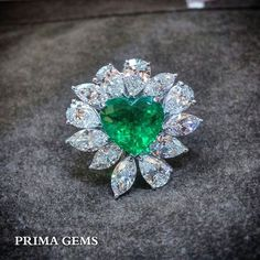 Express your feelings with this emerald heart shaped ring. Emerald Jewelry, Gems Jewelry, High Jewelry, Heart Jewelry, Diamond Jewelry, Jewelery, Diamond Rings, Heart Shaped Rings, Unusual Jewelry