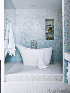 The master bath walls in the same Manhattan penthouse are tiled in Bisazza's Mughetto, and the floors in Ann Sacks's Savoy. The Amalfi tub is by Victoria + Albert.   - HouseBeautiful.com