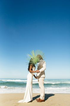 Tropical beach wedding in Mexico: http://www.stylemepretty.com/destination-weddings/mexico-weddings/2016/07/04/see-how-a-wedding-photographer-says-i-do-in-a-beachy-mexican-fiesta/ | Photography:Amanda Lopez, Laura Austin, Frank Harrington