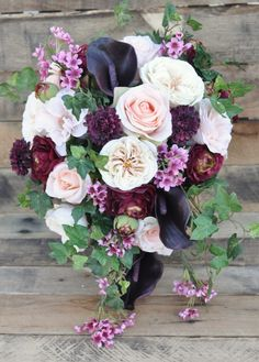 This silk bouquet was just added to Holly's Flower Shoppe on Etsy this week :) See more here: https://www.etsy.com/listing/266569799/cascade-wedding-flowers-wedding-bouquet?ref=shop_home_active_9