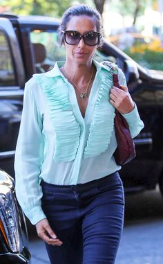 Padma Lakshmi looked perfectly put together in navy trousers, an aqua ruffled blouse, delicate jewelry and oversized softened square shades!