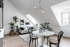 The metal staircase in this beautiful attic home gives this space a industrial loft look. A minimal grey kitchen is placed underneath the metal staircase, making space for a small living area and on the second floor you can find … Continue reading → Attic Spaces, Small Spaces, Small Living Dining, Scandinavian Loft, One Room Apartment, Small Studio Apartments, Black And White Living Room, Black White, Gravity Home